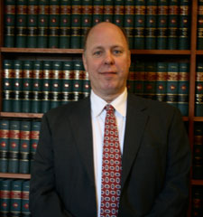 Photo of Bob Temple in his law office