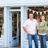 photo of two small business owners in front of their business