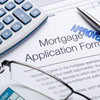 photo of a mortgage application with approved stamped on it