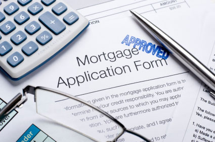 photo of mortgage application that has been stamped with the word approved