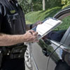 photo of a police officer writing a ticket